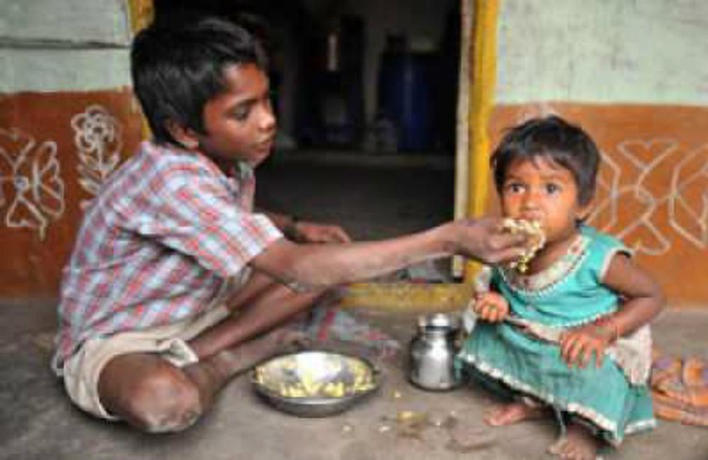child feeds sister