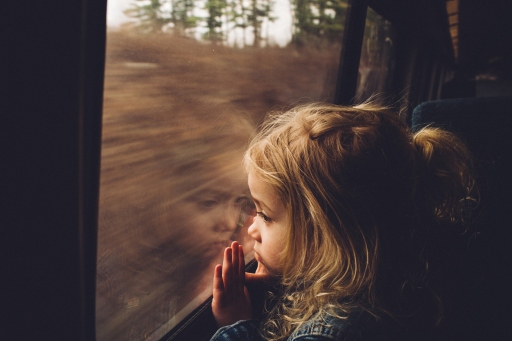 train-window-little-girl