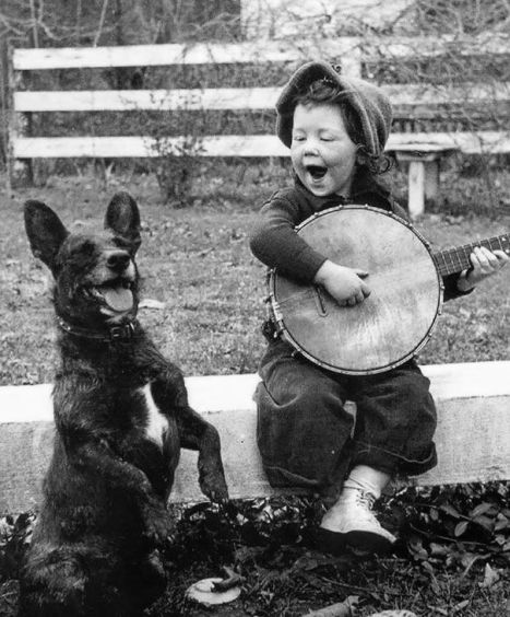 boy-playing-banjo-and-dog